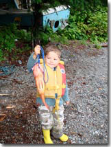 child holding red snapper